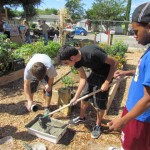 Youths mix cement for arts and craft as part of the Art in the Garden project.