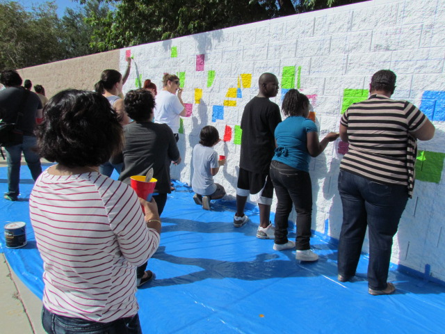Volunteers help paint the Mural for Equality.