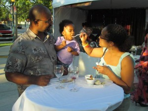 Erica Strawter of Santa Clarita feeds her daughter, Maya, as her husband Charles Strawter looks on, at the 4th Annual Taste of Palmdale.