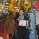 Walmart store manager Trent Blankenship (r) receives a certificate of appreciation from AV Black Chamber of Commerce president Richard Poston at a ceremony Wednesday celebrating Walmart's 20 years of business in Palmdale.