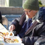 A resident enjoys a home cooked Thanksgiving meal prepared by volunteers.