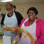 Mayham Long (left) and Debra Funderburk (right) volunteered to serve meals on Thanksgiving Day.