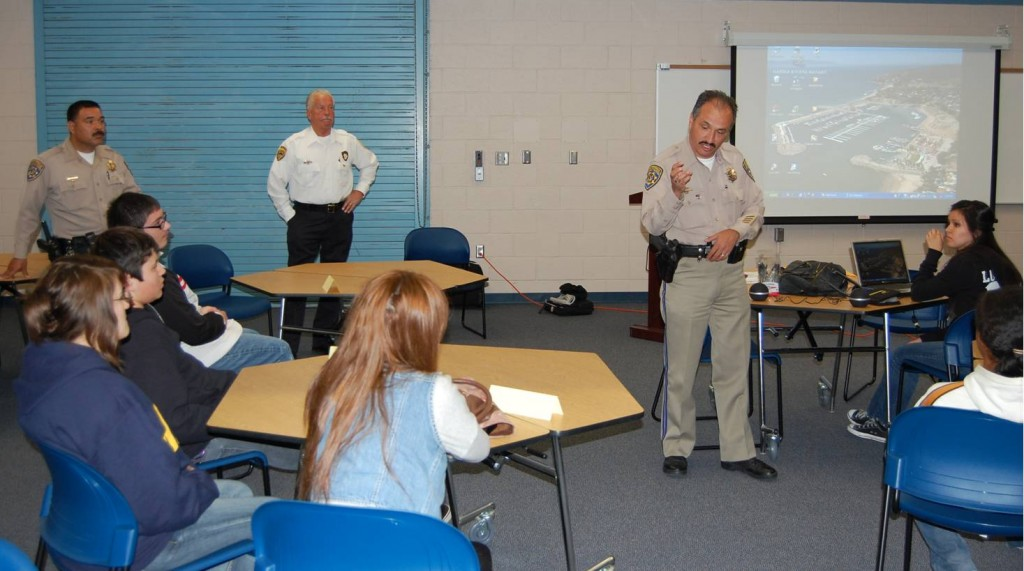 CHP Officer Abel Hernandez speaks to a group of about 20 teens and parents at the Start Smart class at Littlerock High School Wednesday.