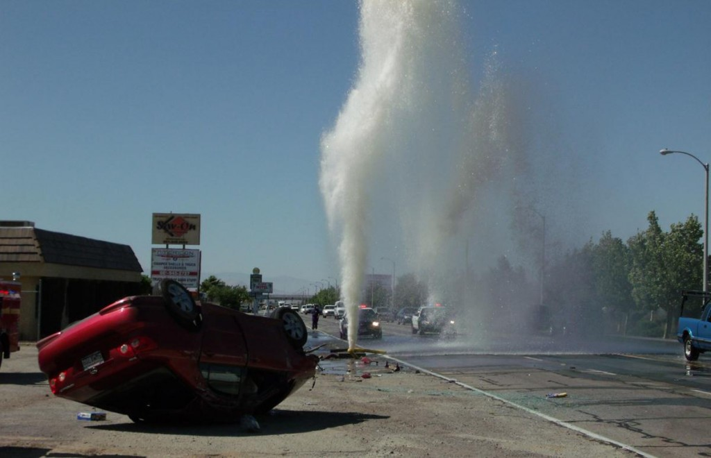 A distracted driver crashed into a fire hydrant on Sierra Highway in June 2012. The car overturned but the driver escaped serious injury. Officers are cracking down on distracted drivers this month.