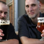 Brewmaster Steven Kinsey (left) and brewer Roger Morrissey raise their glasses to victory. Photo courtesy Charlie Essers.