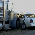 Authorities said a Cadillac ran a stop sign and was broadsided by a big rig Sunday evening (Sept. 2). All four people in the Cadillac died at the scene. (Photo by Austin Raishbrook / RMG News)