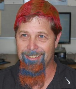 In 2013, Anderson promised his robotics students that if they were invited back to the VEX World Championships, he would temporarily dye his hair and beard. The team achieved the accomplishment and Anderson made good on his promise. Read more here.