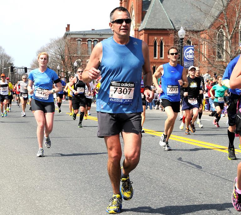 Maj. Jose Gutierrez, U.S. Air Force Test Pilot School Curriculum Standards deputy chief, runs during the Boston Marathon April 15, 2013. (Courtesy photo)