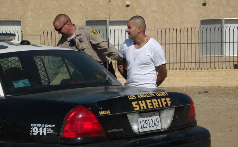 Manuel Contreras, 31, was arrested Sunday afternoon after keeping deputies at bay for several hours. (Photo by LUIS MEZA)