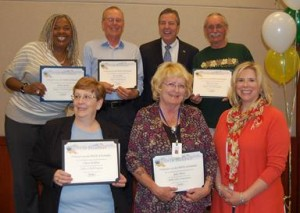 Volunteers from the City's Adopt-A-Wall program.