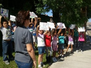 Students from Summerwind Elementary lined the streets to cheer on the cyclists at last year's race.