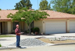 Shumard is removing much of his front yard in an effort to conserve water.
