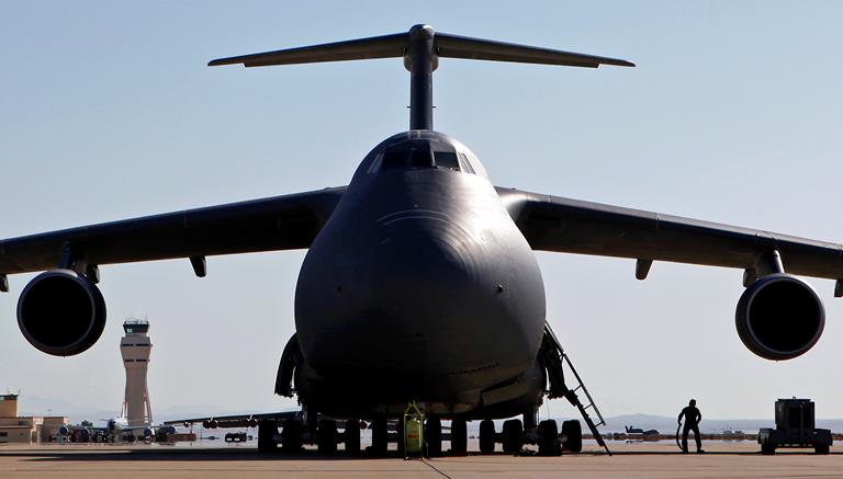 An aircrew member from the 9th Airlift Squadron prepares to remove a power cart from a C-5M Super Galaxy for a test sortie in support of C-5M Super Galaxy Block 3.5.2 software upgrade testing.