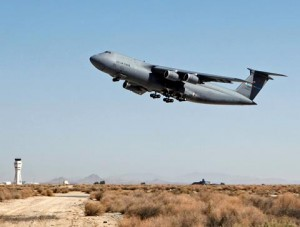 A C-5M Super Galaxy takes off from the runway at Edwards AFB during a flight to test the recent Block 3.5.2 software upgrade.