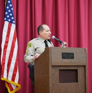 LACo Sheriff Sergeant Andrew Nagel addresses students, staff, and parents.
