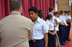 Students receive their Teen CERT completion certificates.