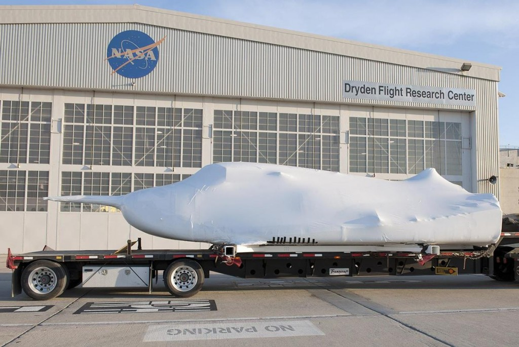 Shrouded in plastic wrap with its wings and tail structure removed for ground transport, Sierra Nevada Corporation's Space Systems Dream Chaser engineering test article arrived for testing on May 15 .