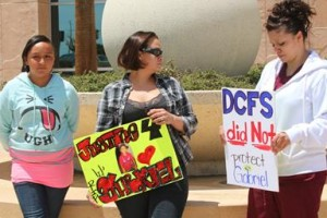 Gabriel's supporters held signs outside the courthouse Tuesday.