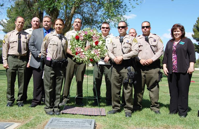Deputies gather at the new grave market for George Curtis, the man who died helping law enforcement nearly 100 years ago.