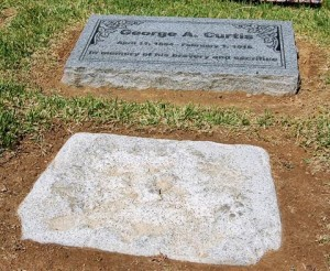The new headstone replaces one so worn you couldn't even read Curtis' name.