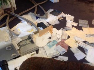 Finding no money in the safe, the vandal scattered important church documents across the soaking wet floor.