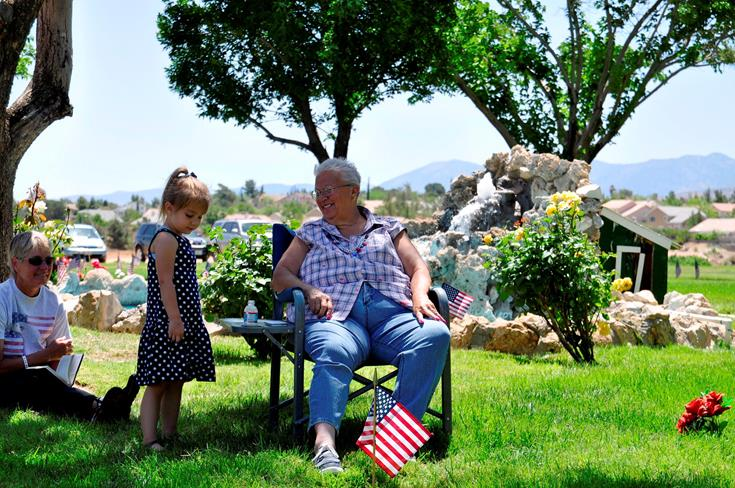 Palmdale resident Marsha Furman and her granddaughter were among many residents who attended the ceremony.