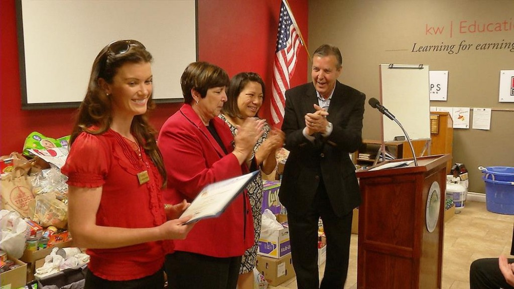 2.Palmdale Mayor Jim Ledford presents a certificate of appreciation to Jessica Wood, while Westside School Superintendent Regina Rossall and SAVES's Patricia Morales look on.