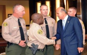 Deputy Sylvester Hardison shakes hands with Sheriff Lee Baca.