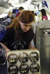 SARP participant Rachel Kirpes assists in the installation of the Whole Air Sampler onboard the NASA's DC-8 flying laboratory.