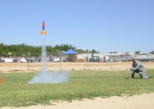 "Col. Robert Weaver launches the rocket named ""Making Sparks Fly."" he rocket was made by a team of fifth graders."