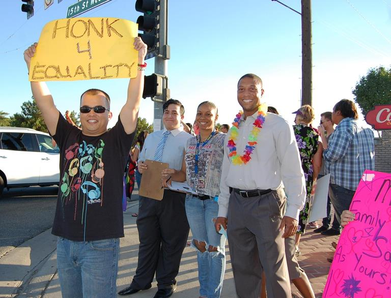 "Matthew Forster (front) flashed a sign asking drivers to ""hon for equality."" The majority of motorists complied."