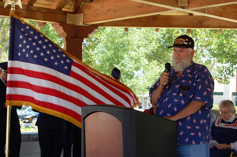 "Phil Roberts of The Retired Enlisted Association led the audience in singing ""You're a Grand Old Flag."""