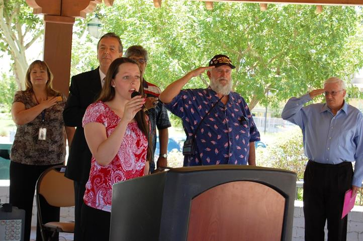 Kim Powell sang the National Anthem.