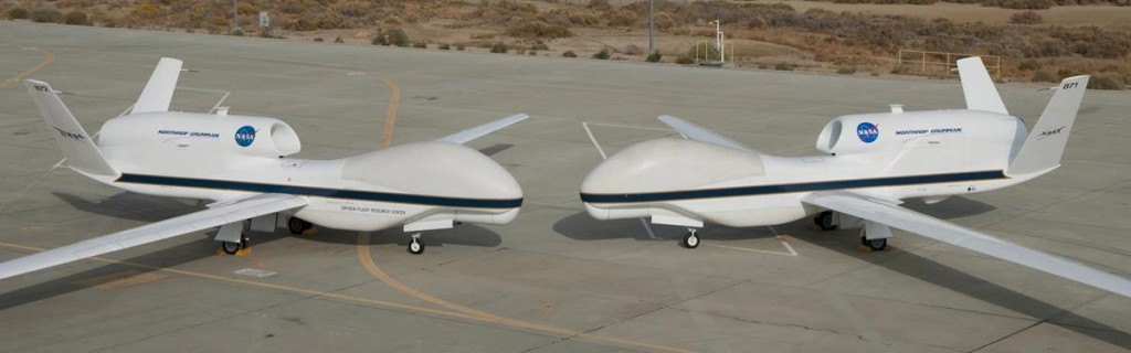 Their bulbous noses almost touching, NASA's two Global Hawks line up nose-to-nose on the ramp at NASA's Dryden Flight Research Center on Edwards Air Force Base, Calif. Developed by Northrop Grumman Corp., the two autonomously operated unmanned aircraft are flown on long-duration environmental sciencemissions. (NASA / Tony Landis)