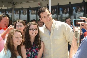 Cavill poses with moviegoers.
