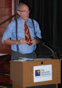 Guest director Felty displays his 1940s styled tie at a press conference held Wednesday.