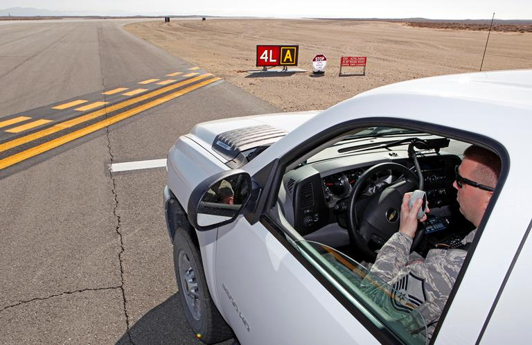 The 412th Operations Support Squadron Airfield Management team took the distinct honor of being named the 2012 Ronald McCarthy Airfield Management Facility of the Year in a competition across the Air Force on June 25, 2013. The award and competition is a way of recognizing the hard work accomplished by those in the Airfield Management career field (U.S. Air Force photo by Jet Fabara)