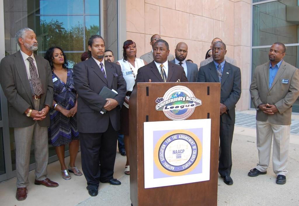 Surrounding by leaders of various local civil rights organizations, AV-NAACP President V. Jesse Smith speaks at a press conference at Antelope Valley courthouse to address the results of a Justice Department investigation.