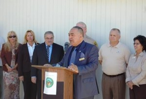 Al-Khatib speaks at a press conference to introduce the school's new K-9 unit.
