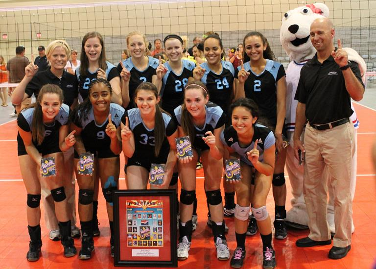 Local girls Lyndsay Mlynar (#33) and Brittni Dorsey (#2) pose for a picture with their championship winning Legacy Volleyball Club, along with coaches Gerrit Maxwell and Wendy Maxwell.