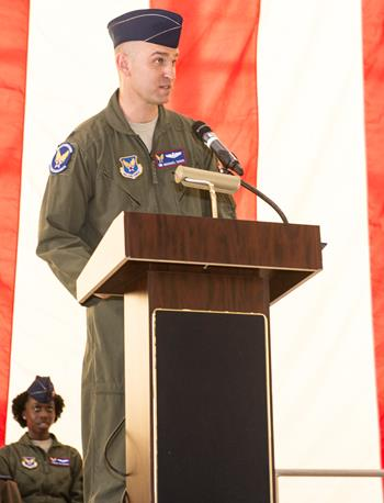 Lt. Col. Michael Davis addresses members of the 412th Flight Test Squadron in Hanger 1600 July 2 after assuming command of the squadron. (U.S. Air Force photo by Edward Cannon)