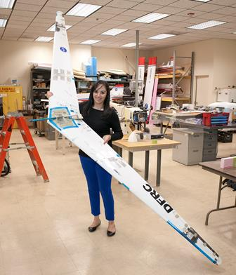 Piñón holds the radio-controlled Prandtl-D flying wing she helped to design and build. (NASA / Tom Tschida)