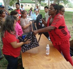 One Way Up CEO Cynthia Beverly (in red) said she does the event to see the smiles on children's face. (Photo courtesy One Way Up.)