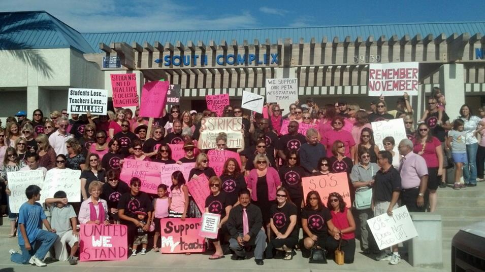 More than 200 teachers and parents gathered outside the Palmdale School District office Friday to show support and unity for the PETA Bargaining Team.