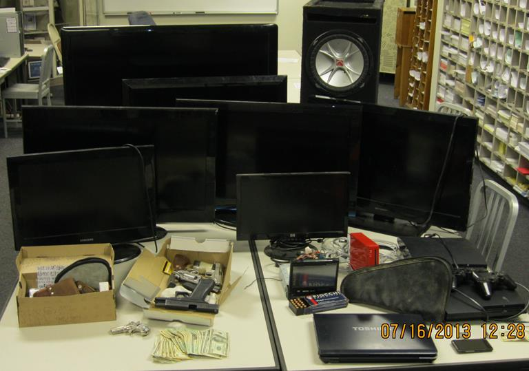 Five stolen handguns, numerous flat screen televisions, gaming systems, and approximately $2,000 in cash were recovered. (Courtesy LASD)