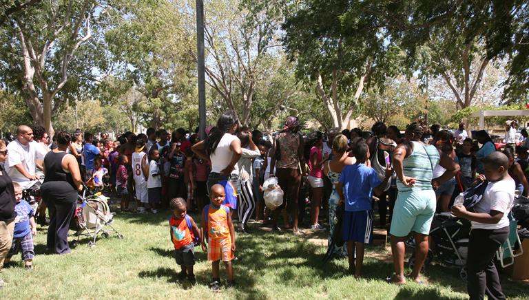 Hundreds came out to the Third Annual One Way Up Backpack Giveaway and Fun Day on Aug. 17. (Photo courtesy Simac Production Studios.)