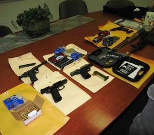 Four handguns, two rifles and one pound of marijuana were also seized.