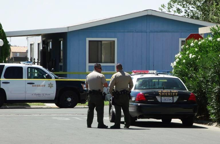 A gunshot victim was found inside a mobile home at Desert Sands Estates in east Lancaster Wednesday afternoon. Authorities have little information and are asking for the public's help in finding a suspect. (Photo by LUIS MEZA)