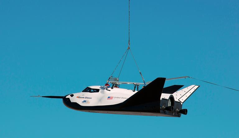 Sierra Nevada Corporation's Dream Chaser engineering test spacecraft is suspended from a cable from a large helicopter during its captive carry test Aug. 22 at NASA Dryden. (NASA / Ken Ulbrich)