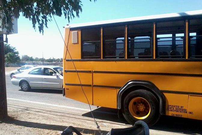 Palmdale resident and parent Toi-Riana Thompson  snapped this photo Wednesday afternoon, showing the school bus dropping off students at Avenue Q by 10th Street East. In the photo, a vehicle appears to be trying to drive around the school bus. Thompson believes the new bus route puts the elementary students in danger.